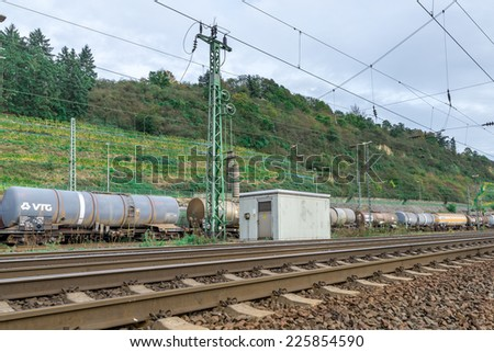 Image of trains and carriages on a railway track leading into the distance - stock photo