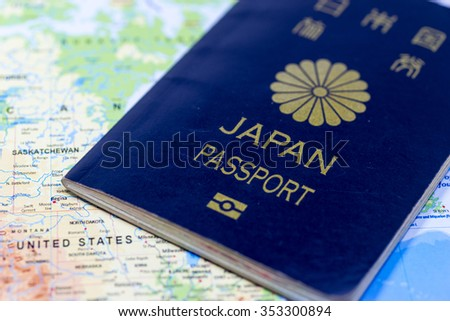Image of travel, with Japanese passport and map - stock photo
