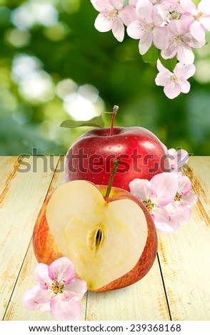 image of two apples on a wooden table - stock photo