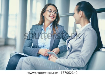 Image of two confident businesswomen discussing new ideas - stock photo