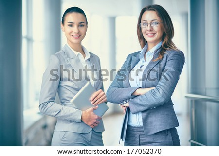 Image of two confident businesswomen looking at camera - stock photo