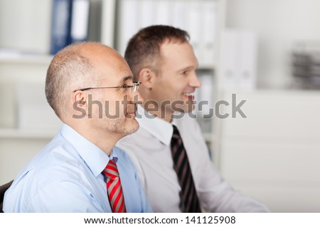 Image of two employees looking at businessperson explaining idea at the meeting - stock photo