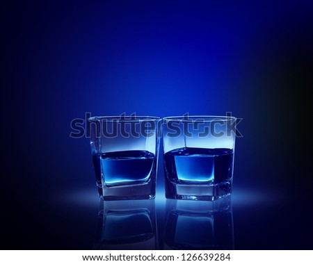 Image of two glasses of blue liquid - stock photo