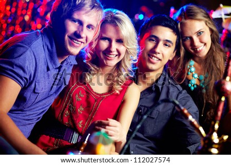 Image of two happy couples having party - stock photo
