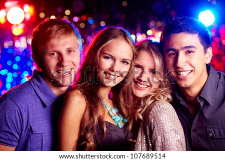 Image of two happy couples looking at camera at party - stock photo