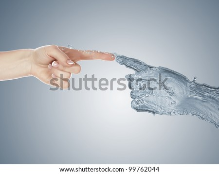 Image of two human hands touching each other - stock photo