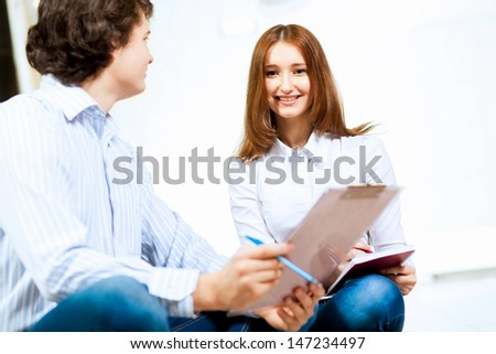 Image of two students discussing their work