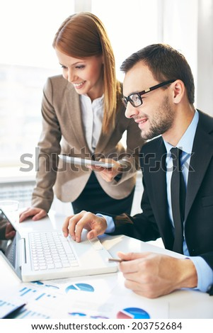 Image of two successful business partners working at meeting in office - stock photo