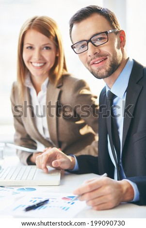 Image of two successful business partners working together - stock photo