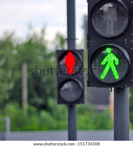 image of two traffic signals  on a background of trees - stock photo
