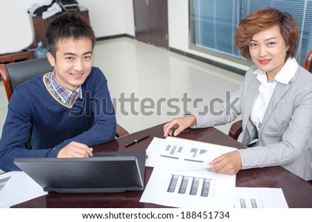 Image of two young businessmen using laptop at meeting - stock photo
