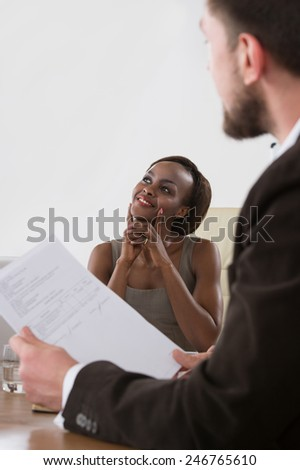 Image of two young businesspeople of diverse ethnicity businessman and businesswoman at meeting