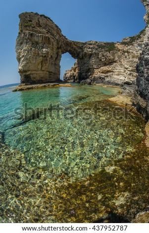 Image of unique and scenic arch in the cliffs, Paxi, Greece