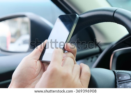 image of using a mobile phone inside of a car