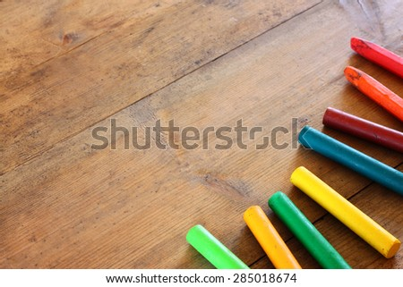 image of various colorful crayons on wooden table  - stock photo