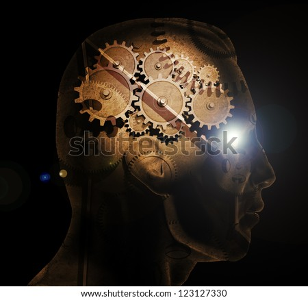 Image of various gears inside of a man's head on a black background. - stock photo