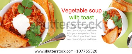 image of vegetable soup with spoon and sour cream - stock photo