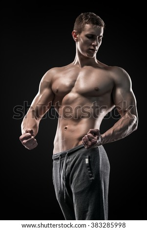 Image of very muscular man posing with naked torso - stock photo