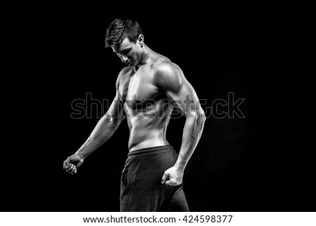 Image of very muscular man posing with naked torso