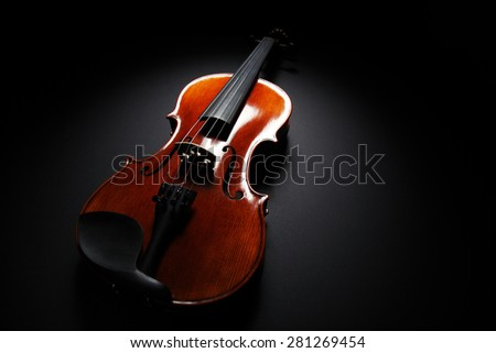 Image of violin music instrument on black background in spot of light - stock photo