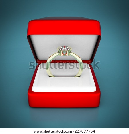 image of wedding rings in a gift box on blue background