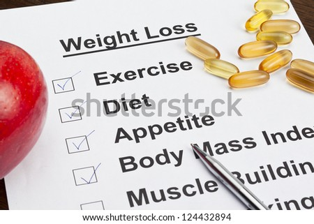 Image of weight loss list with on black background - stock photo