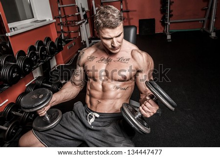 Image of well looking bodybuilder who is having workout