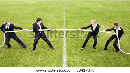Image of white collar worker pulling the rope in the stadium - stock photo
