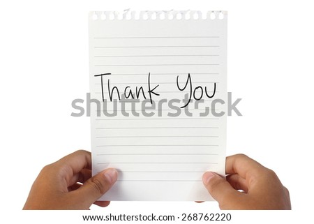 Image of white note paper, held by child hands with Thank You words written on it - stock photo