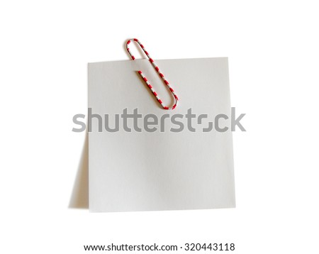 Image of white note paper with color paperclip isolated on white background. Clipping path included. - stock photo