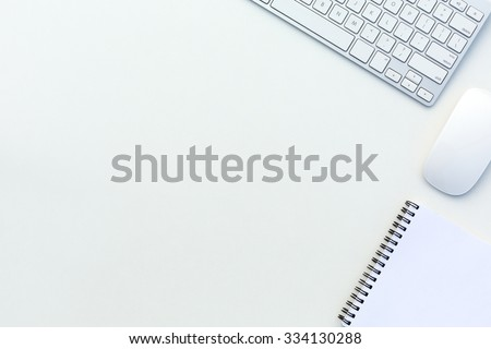 Image of White Office Table with Computer Keyboard Mouse and Paper Notepad Top View - stock photo