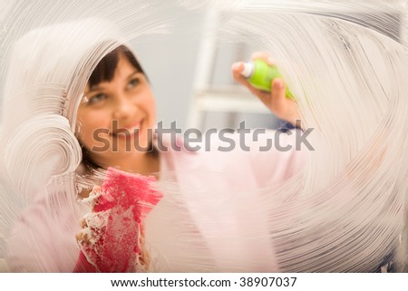 Image of window being washed by housekeeper