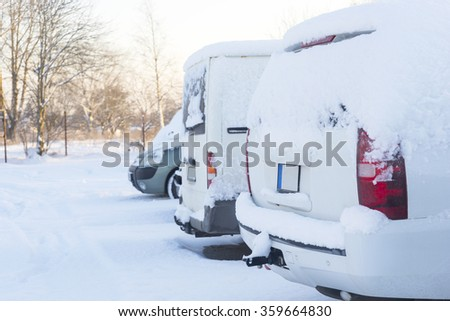 Image of Winter parking lot with cars covered with snow - stock photo