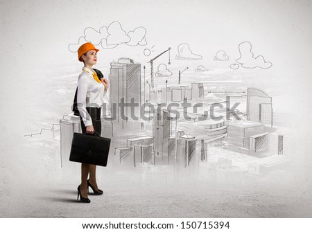 Image of woman engineer in helmet with drafts. Construction concept
