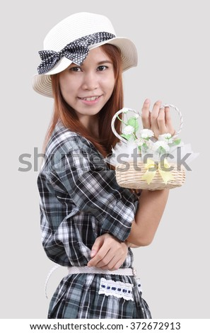 Image of woman hold flowers bag with blurred background
