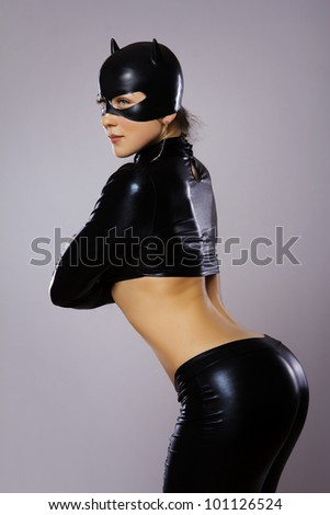 Image of woman in cat costume - stock photo