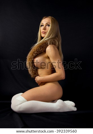 Image of woman's bare chest closeup portrait of a female sexy big breast / sexy breast xxl / Beautiful slim body of woman in studio / hot sexy blonde girl with white socks, fox fur isolated close up - stock photo