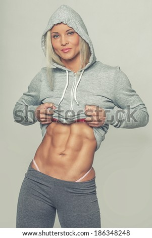 Image of woman with barely seen panties from her leggings - stock photo