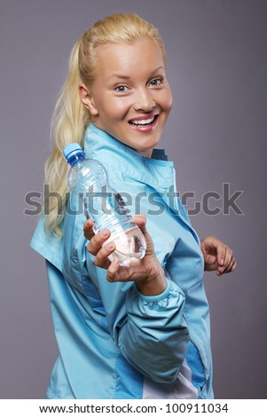 Image of woman with bottle of water