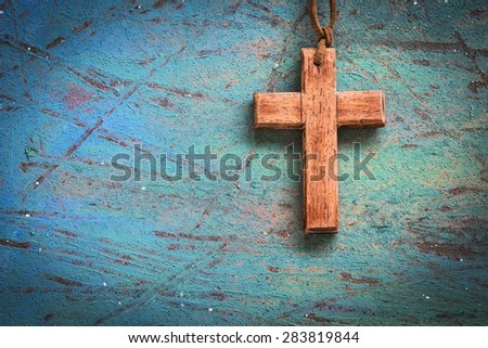 Image of wooden cross on blue retro background - stock photo