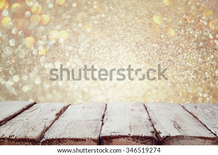 image of wooden old table in front of glitter snow background. selective focus  - stock photo