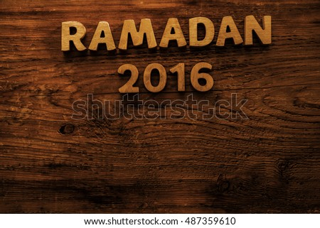 Image of word RAMADAN 2016 year on wooden background, close up. empty copy space for inscription or other objects. Religion and holiday backdrop