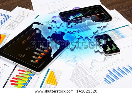 Image of working place with mobile phone, and tablet PC - stock photo