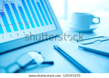 Image of workplace with paper and electronic documents on desk - stock photo