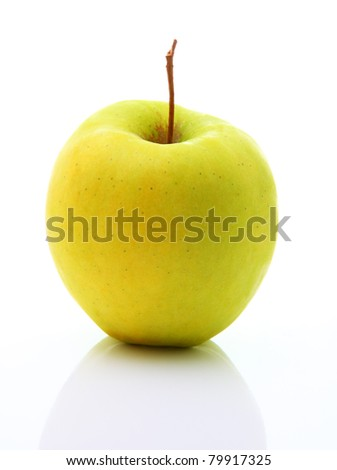 Image of yellow apple with reflection isolated over white background - stock photo