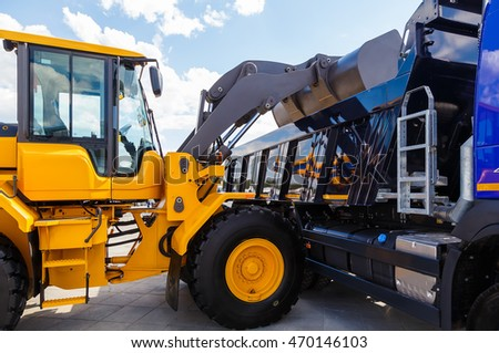 Image of yellow bulldozer load into a truck
