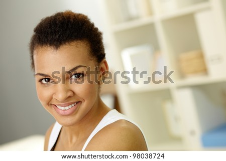 Image of young African girl looking at camera with smile - stock photo