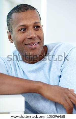Image of young African man looking aside with calm expression - stock photo