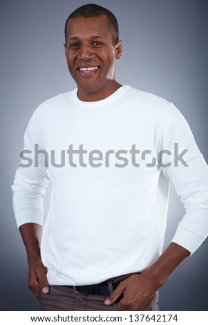 Image of young African man looking at camera with smile - stock photo