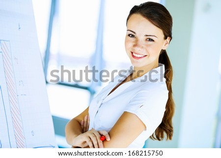 Image of young attractive businesswoman with arms crossed on chest